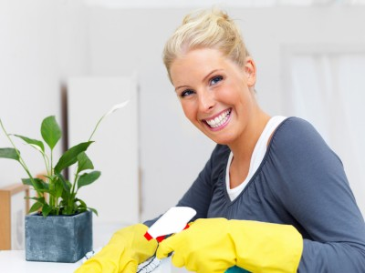 Portrait of an attractive blond woman cleaning your house